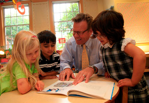 Head of School reading with students
