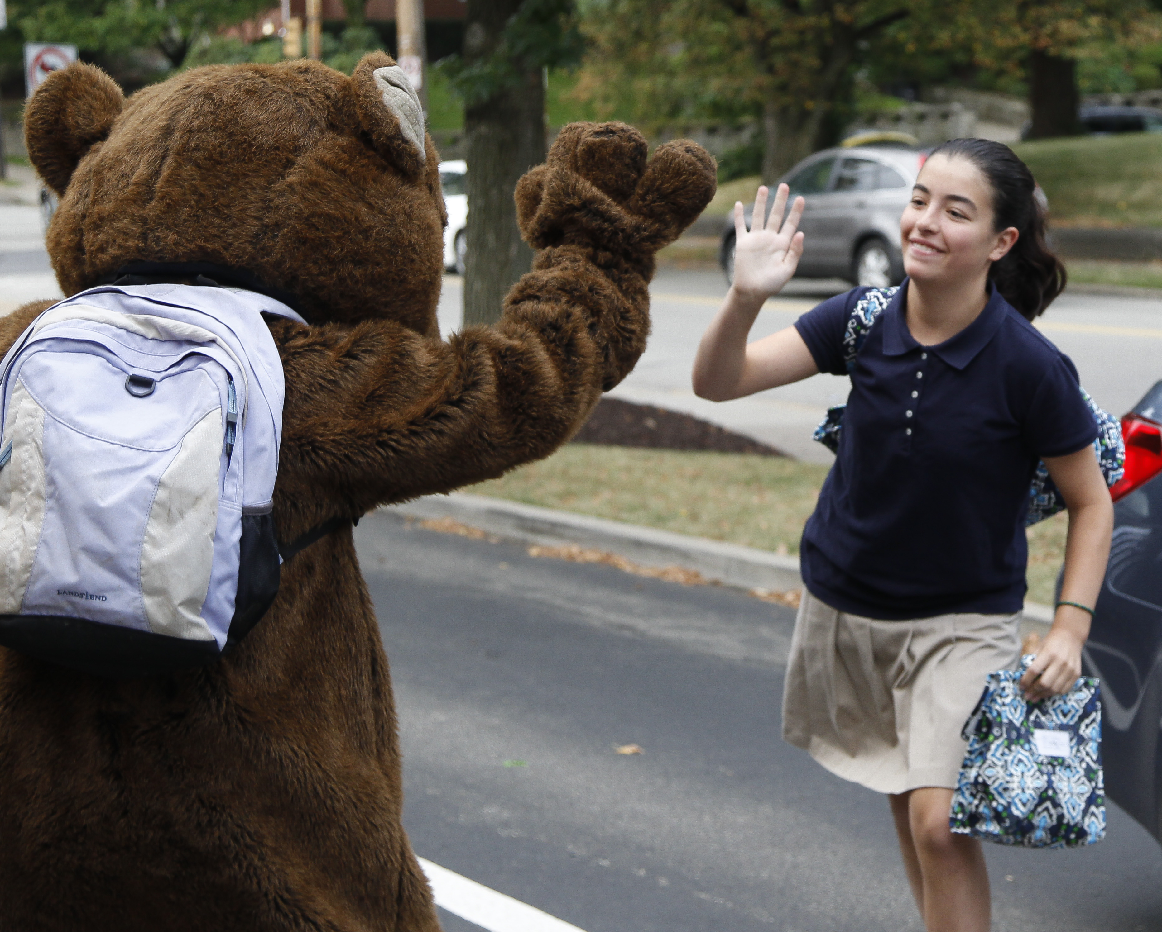 WT mascot giving student high-five